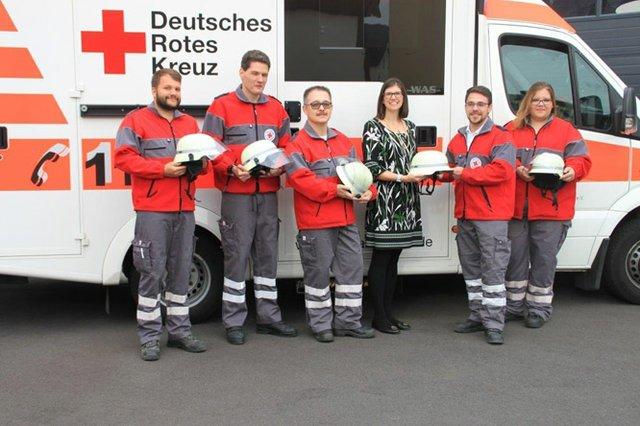 Wells Bullard presented Bullard helmets to members of the German Red Cross, in recognition of their efforts to service their community..jpg