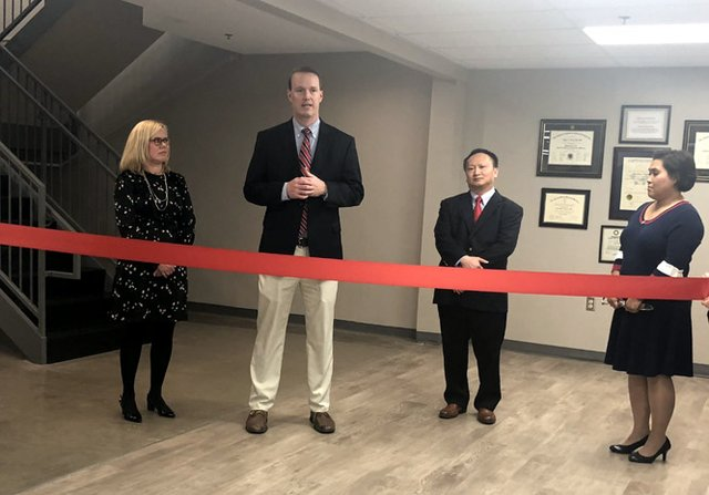 Stamps_IndyBiz_2nd Chance Clinic at ribbon-cutting ceremony Nov. 2, 2018_Susan Bishop, DMD_ Marvin Bishop, M.D., Tuyen Tran, M.D., Lynh Tran..jpg