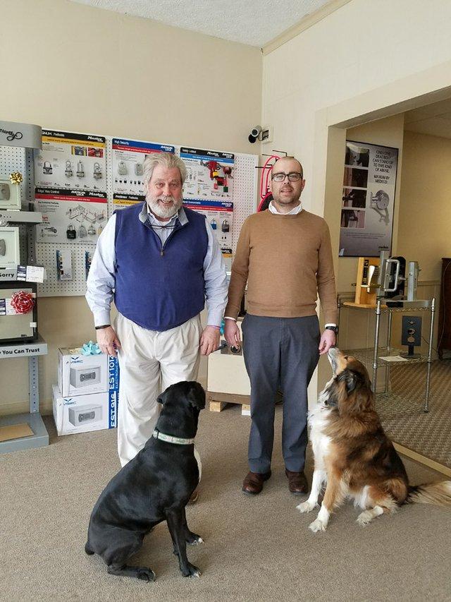Burdine_David Burdine (left) and Will Burdine with Bella the boxer and Roxy the collie.jpg