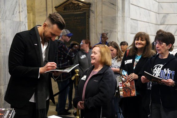 JD Shelburne signs copies of Kentucky's Official Visitor Guide for 2020.JPG