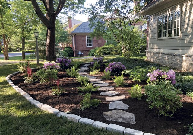 New Era Landscape used Hickory gray steppers, Fond du Lac edging and premium hardwood mulch from Landscapers Corner on this residential project_photo courtesy of  New Era Landscape and Construction.jpg