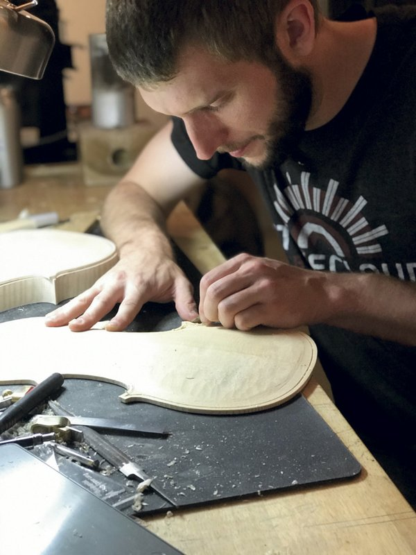 Kre8Now member Ben Mason works on a custom violin.jpg