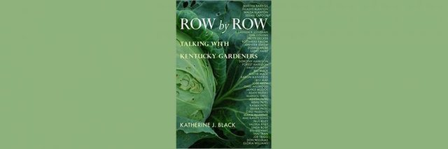 "Katherine J. Black signs ""Row by Row"""