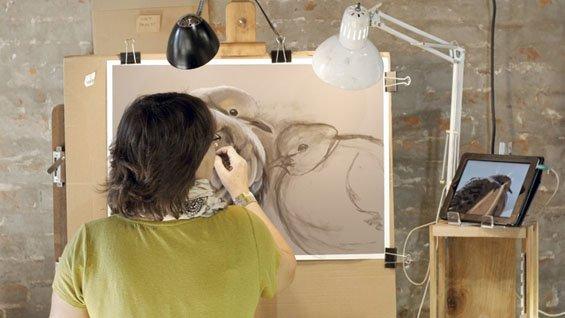 debbie looking and painting behind.jpg