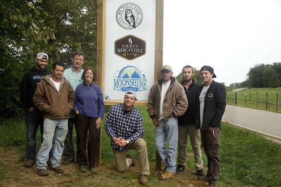 Laura Freeman and farm staff.jpg