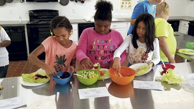 FoodChain elementary students learn to cook.jpg
